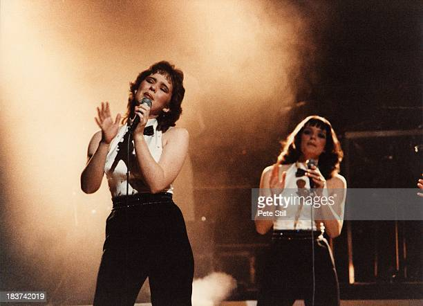 Coleen Nolan and Anne Nolan of The Nolans perform on stage at the Dominion Theatre on November 30th 1982 in London England