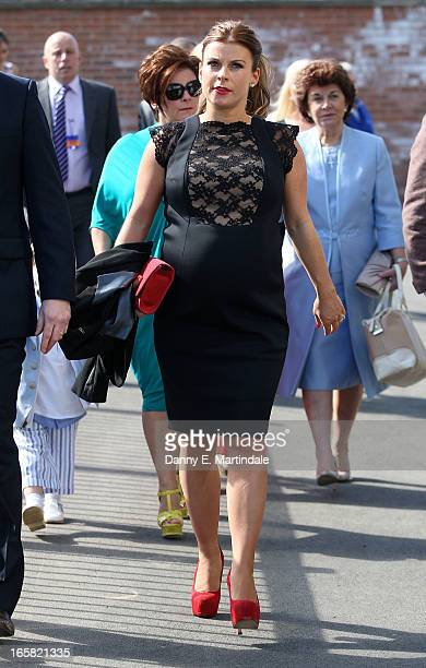Coleen Rooney and mother Colette McLoughlin attend the Grand National Day at Aintree on April 6 2013 in Liverpool England Millions of pounds are...