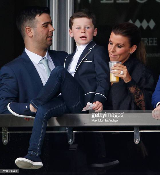 Coleen Rooney and son Kai Rooney watch the racing as they attend day 3 'Grand National Day' of the Crabbie's Grand National Festival at Aintree...