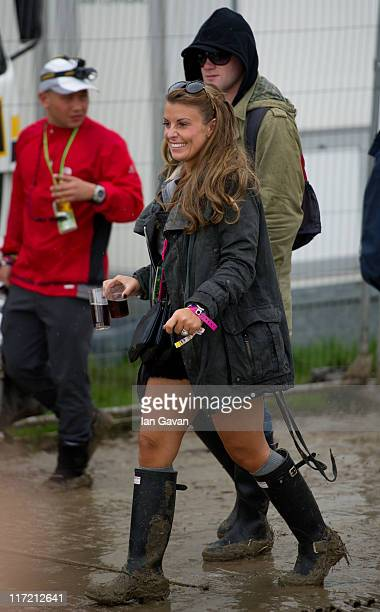 Coleen Rooney and Wayne Rooney walk through the hospitality area during the Glastonbury Festival at Worthy Farm Pilton on June 24 2011 in Glastonbury...