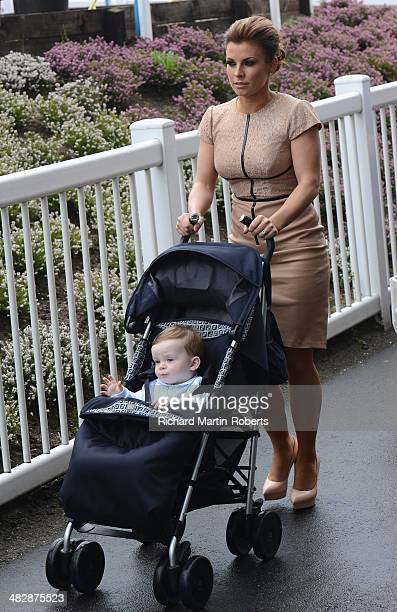 Coleen Rooney arrives with son Klay Anthony on Day 3 Grand National day of the Aintree races at Aintree Racecourse on April 5 2014 in Liverpool...