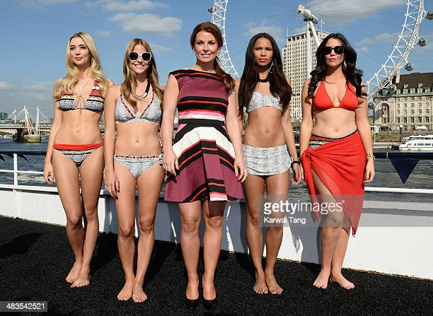 Coleen Rooney attends a photocall to launch her Fashion and Swimwear SS14 collection for Littlewoodscom on April 9 2014 in London England