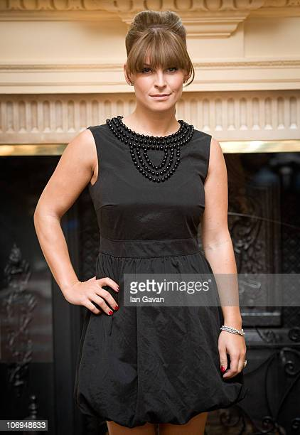 Coleen Rooney attends a photocall to launch her SS11 fashion collection designed for Littlewoodscom at Claridges Hotel on November 18 2010 in London...