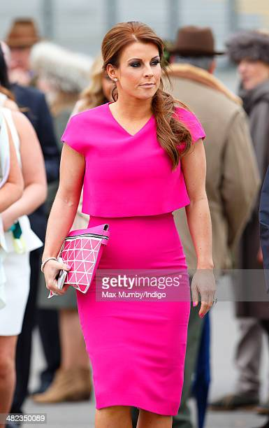 Coleen Rooney attends day 1 of the Crabbie's Grand National horse racing meet at Aintree Racecourse on April 3 2014 in Liverpool England