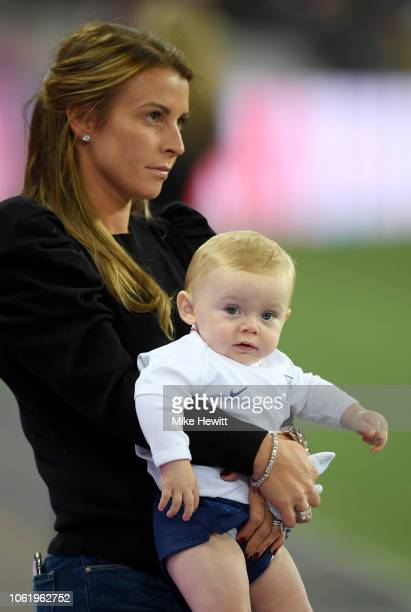 Coleen Rooney holding Cass Mac Rooney looks on prior to the International Friendly match between England and United States at Wembley Stadium on...