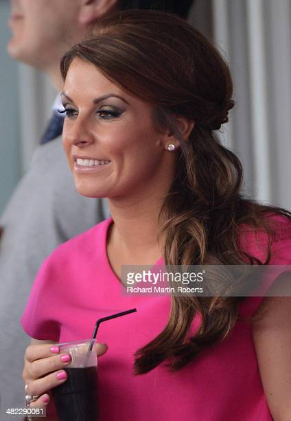 Coleen Rooney looks on during Day 1 of the Aintree races at Aintree Racecourse on April 3 2014 in Liverpool England