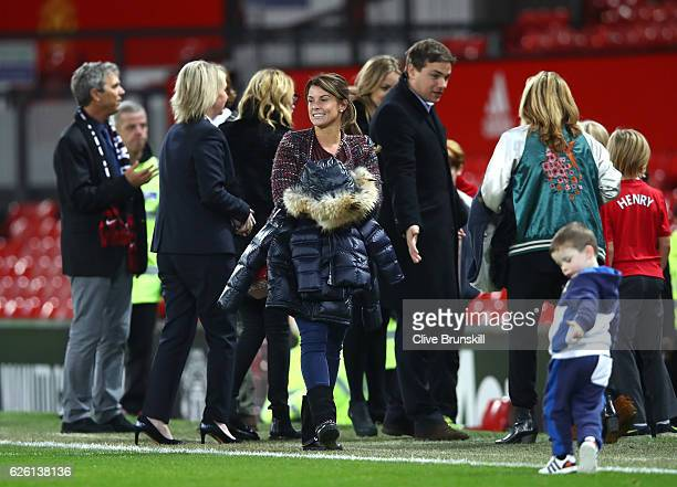 Coleen Rooney looks on from pitchside after the Premier League match between Manchester United and West Ham United at Old Trafford on November 27...