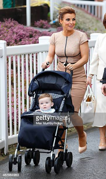 Coleen Rooney pushes son Klay Rooney in his pushchair as they attend the Crabbie's Grand National horse racing meet at Aintree Racecourse on April 5...