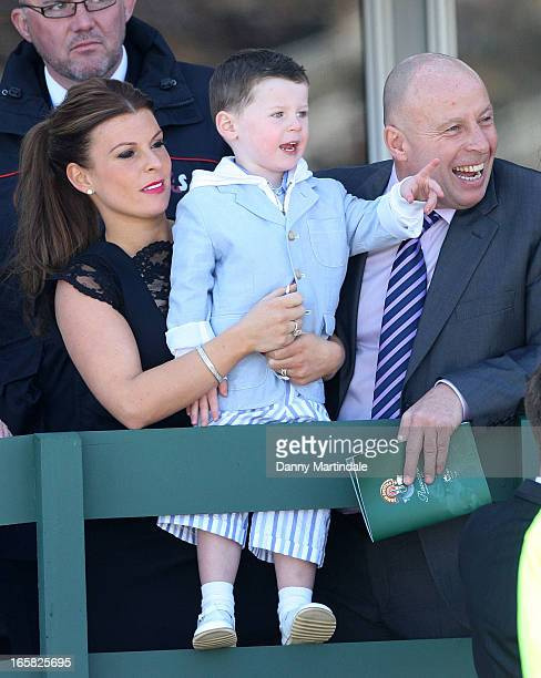 Coleen Rooney son Kai Rooney and father Tony McLoughlin attend the Grand National at Aintree Racecourse on April 6 2013 in Liverpool England