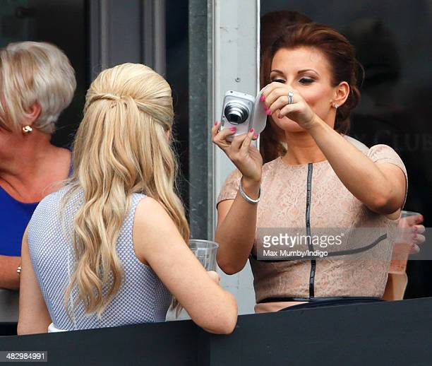 Coleen Rooney taking photographs as she attends the Crabbie's Grand National horse racing meet at Aintree Racecourse on April 5 2014 in Liverpool...