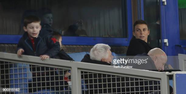 Coleen Rooney watches from a box during the Premier League match between Everton and Manchester United at Goodison Park on January 1 2018 in...