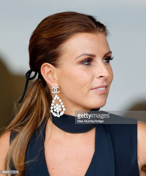 Coleen Rooney watches the racing as she attends day three 'Grand National Day' of The Randox Health Grand National Festival at Aintree Racecourse on...