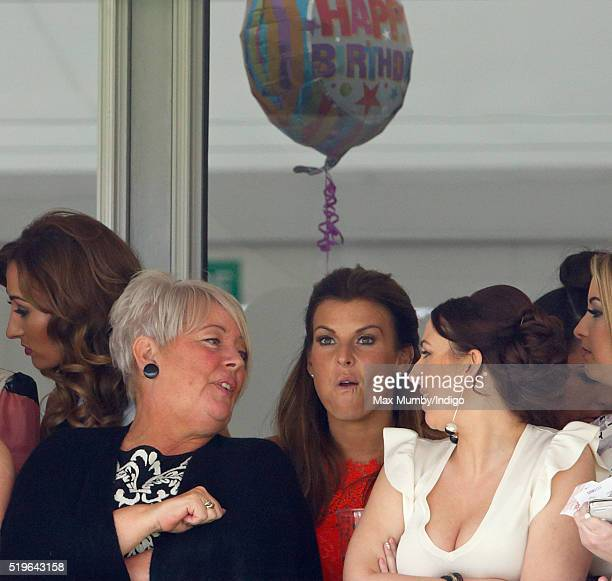 Coleen Rooney watches the racing on day 1 'Grand Opening Day' of the Crabbie's Grand National Festival at Aintree Racecourse on April 7 2016 in...