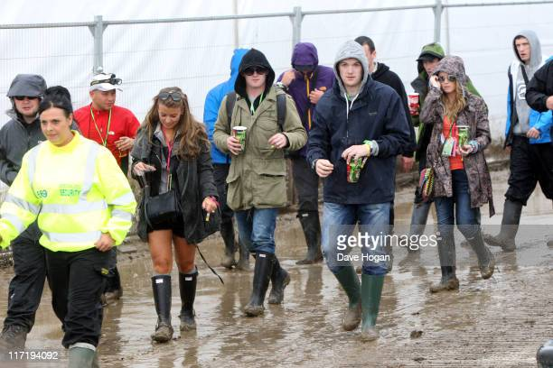 Coleen Rooney Wayne Rooney and John Rooney attend the Glastonbury Festival at Worthy Farm Pilton on June 24 2011 in Glastonbury England The festival...