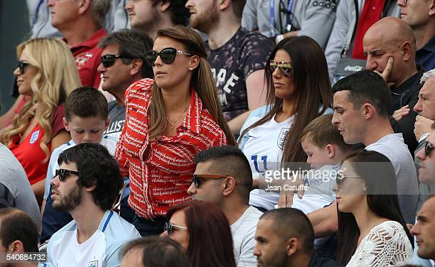 Coleen Rooney wife of Wayne Rooney with their sons Kai Rooney and Klay Rooney sit in front of Rebekah Vardy wife of Jamie Vardy during the UEFA EURO...