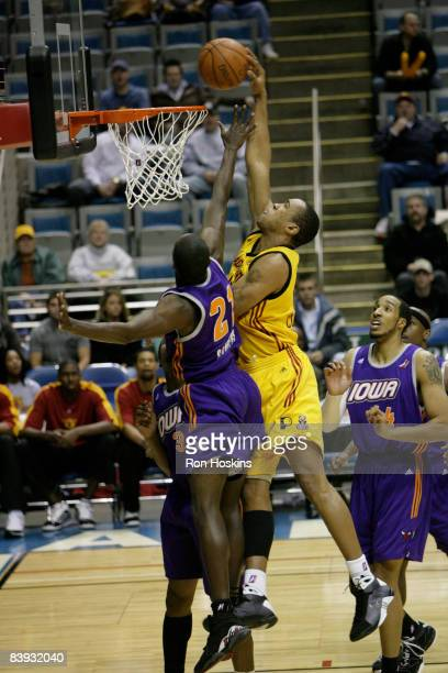 Coleman Collins of the Fort Wayne Mad Ants scores over Patrick Sanders of the Iowa Energy at Allen County Memorial Coliseum on December 5 2008 in...