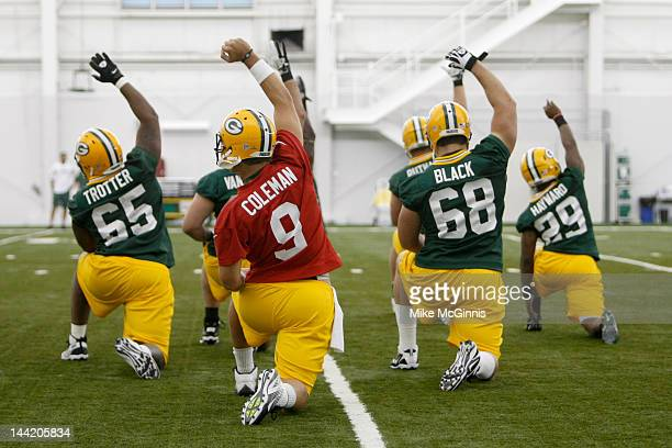 J Coleman Frank Trotter Luke Black and Casey Hayward of the Green Bay Packers stretch before mini camp at the Don Hutson Center on May 11 2012 in...
