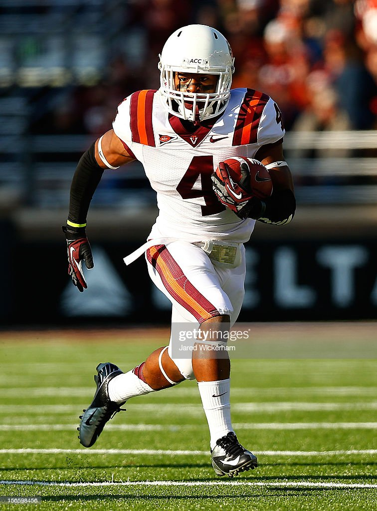 J.C. Coleman #4 of the Virginia Tech Hokies runs with the ball against the Boston College Eagles during the game on November 17, 2012 at Alumni Stadium in Chestnut Hill, Massachusetts.
