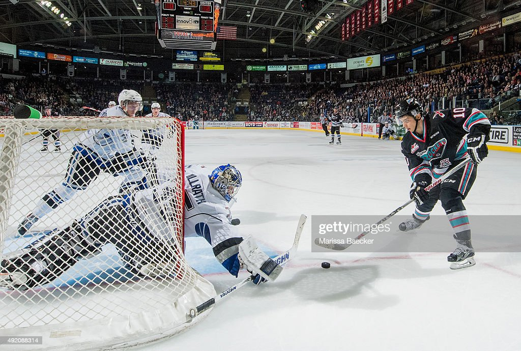 Coleman Vollrath #35 of Victoria Royals blocks a shot from Nick Merkley #10 of Kelowna Rockets on OCTOBER 9, 2015 at Prospera Place in Kelowna, British Columbia, Canada.