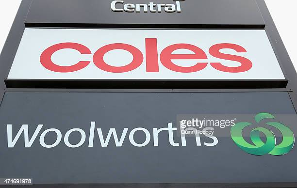 Coles and Woolworths signs are seen outside a shopping centre on May 25 2015 in Melbourne Australia In a bid to regain its title as Australia's...
