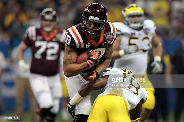 J Coles of the Virginia Tech Hokies makes a catch in the first quarter against Blake Countess of the Michigan Wolverines during the Allstate Sugar...