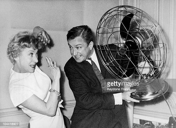 Colette Brosset And Robert Dhery Playing With A Fan On March 15, 1961.\Both Were Preparing To Play Together In The Film La Belle Americaine.