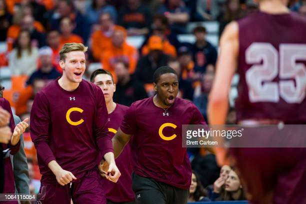 Colgate Raiders bench players celebrate during the first half against the Syracuse Orange at the Carrier Dome on November 21 2018 in Syracuse New York