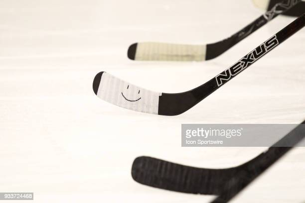 Colgate Raiders player's smiley face on their stick tape during the National Championship game between the Clarkson Golden Knights and the Colgate...