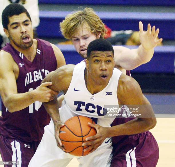 Colgate's Alex Ramon left and Dana Batt try to stop TCU's Brandon Parrish as he takes the rebound in the first half at the University Recreation...