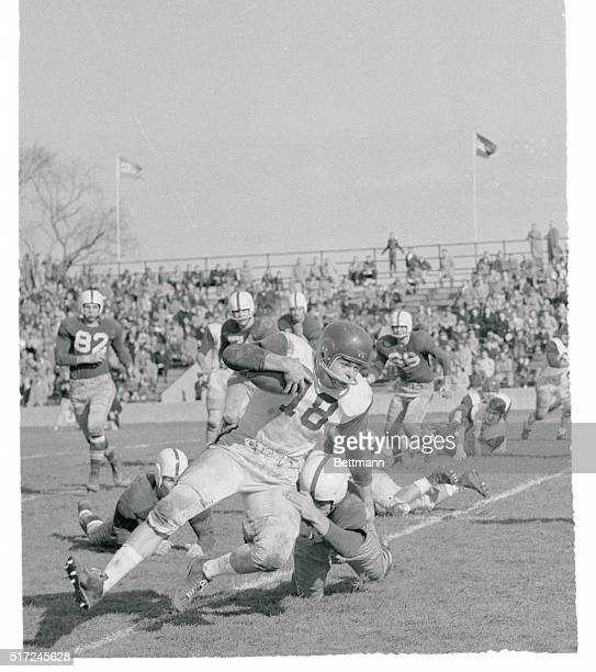 Colgate's John Call gains four yards before being brought down by Archie Williams of Brown in the first period of their November 24th game at...