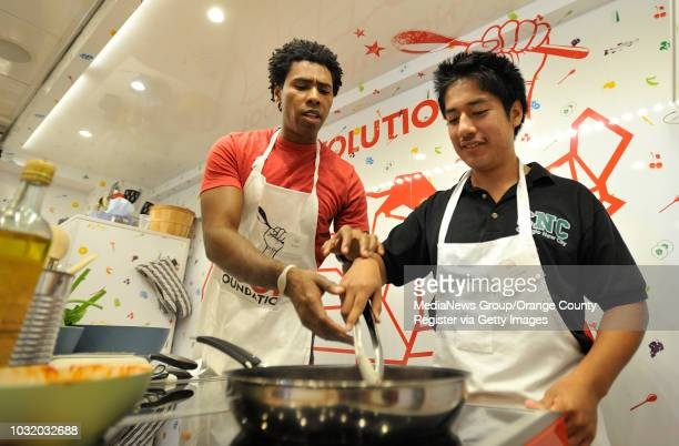 BEACH CALIF USA Coligeo High School students Estivan Garcia right gets some help from instructor Nei Assis as they make barbecued chicken lettuce...