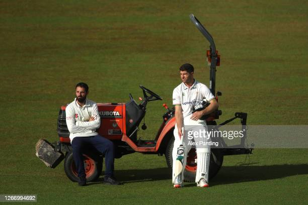 Colin Ackermann of Leicestershire in conversation with Ned Eckersleyon the pitch as he awaits the umpires decision on the rain delay during day four...