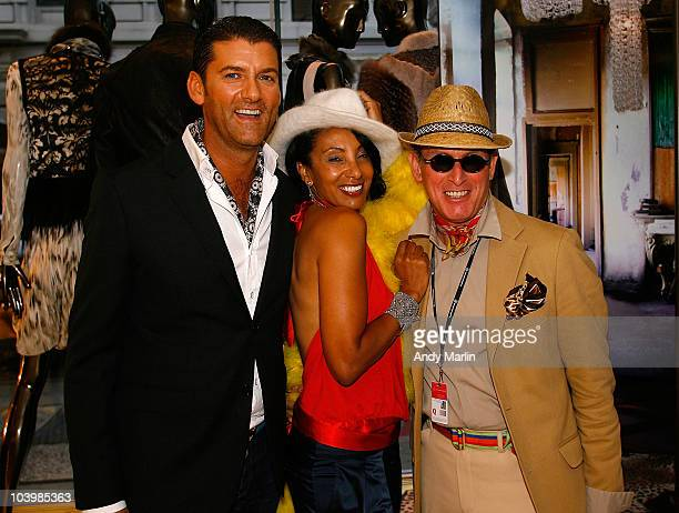 Colin actress and former MTV VJ Julie Brown and Montgomery pose for a photo during Roberto Cavalli Celebrates Fashion's Night Out at Roberto Cavalli...