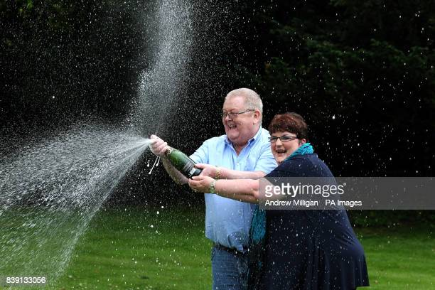Colin and Chris Weir from Largs in Ayrshire celebrate during a photo call at the Macdonald Inchyra Hotel Spa in Falkirk after they scooped 161...