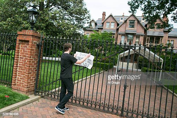 STATES MAY 9 Colin Anhut a native of Raleigh NC tapes a sign on the gate outside of the Governor's Mansion in Raleigh NC on Monday May 9 2016 Gov Pat...