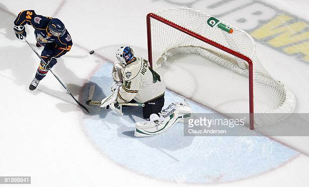 Colin Behenna of the Barrie Colts tips a shot on Michael Hutchinson of the London Knights in a game on October 16 2009 at the John Labatt Centre in...