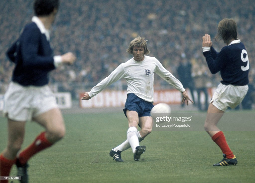 Colin Bell of England (centre) in action against Scotland during the international football match at Wembley Stadium in London on 19th May 1973. England won 1-0.