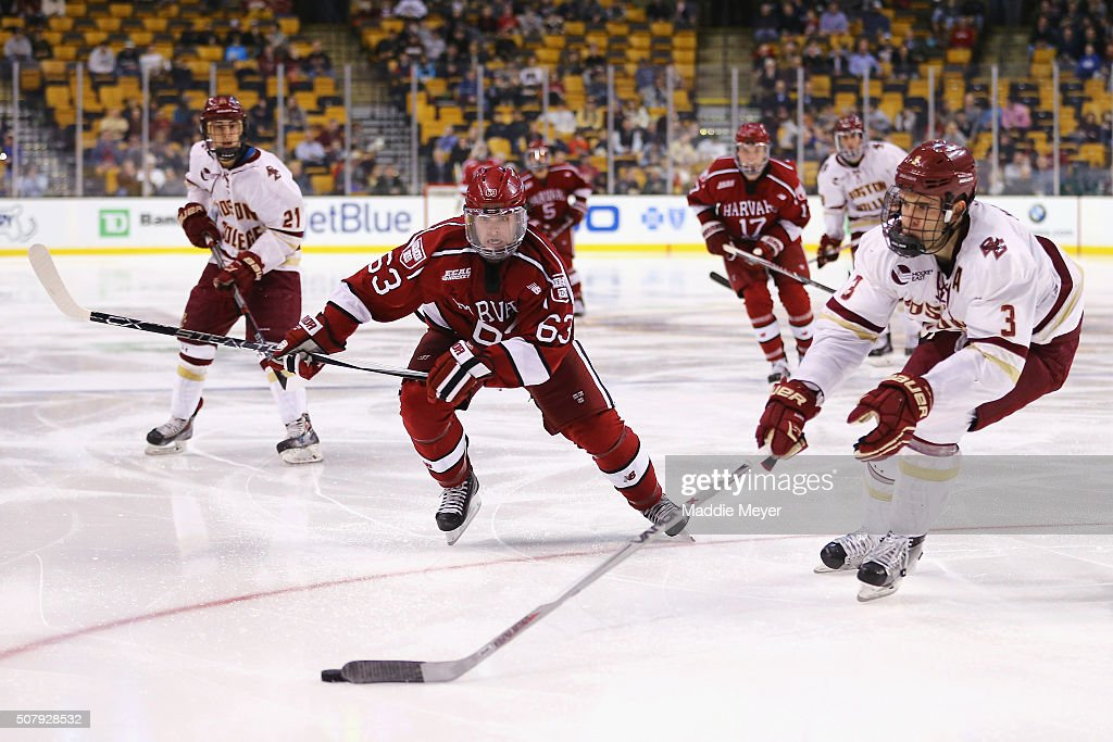 Colin Blackwell #63 of the Harvard Crimson skates against Ian McCoshen #3 of the Boston College Eagles during the second period at TD Garden on February 1, 2016 in Boston, Massachusetts.