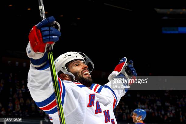 Colin Blackwell of the New York Rangers celebrates after scoring a goal against the New York Islanders during the second period at Nassau Coliseum on...