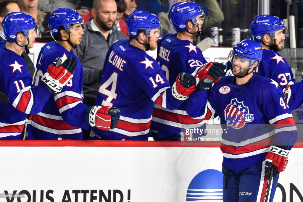 Colin Blackwell #43 of the Rochester Americans celebrates his third-period goal with teammates on the bench against the Laval Rocket during the AHL game at Place Bell on October 25, 2017 in Montreal, Laval, Canada. The Rochester Americans defeated the Laval Rocket 5-2.
