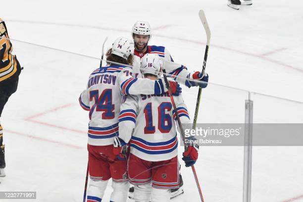 Colin Blackwell, Vitali Kravtsov and Ryan Strome of the New York Rangers celebrate the third period goal against the Boston Bruins at the TD Garden...