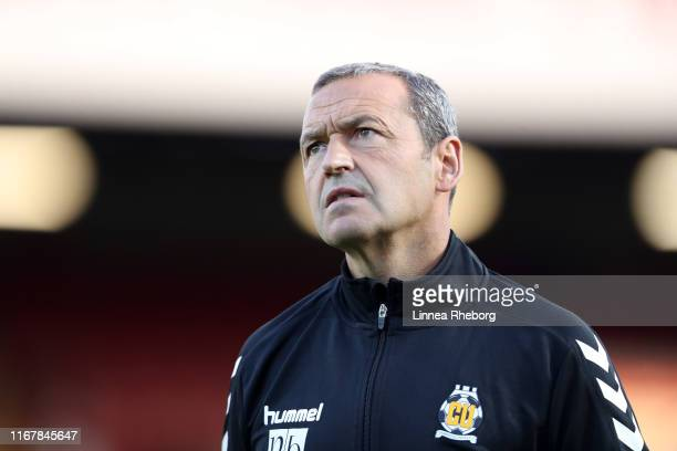 Colin Calderwood Manager of Cambridge United makes his way to the bench prior to the Carabao Cup First Round match between Brentford and Cambridge...