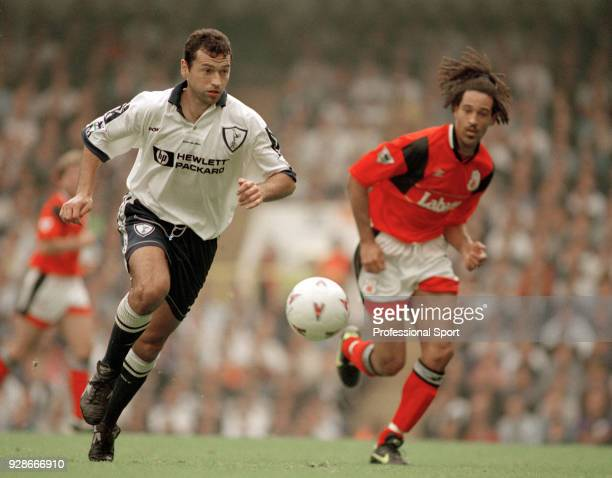 Colin Calderwood of Tottenham Hotspur is chased by Jason Lee of Nottingham Forest during an FA Carling Premiership match at White Hart Lane on April...