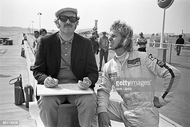 Colin Chapman, Lotus team owner and his driver Reine Wisell at the Questor Grand Prix in which Formula One cars competed with Formula A cars on March...
