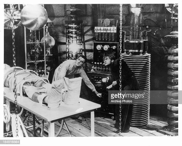 Colin Clive and Dwight Frye in laboratory with monster in a scene from the film 'Frankenstein', 1931.