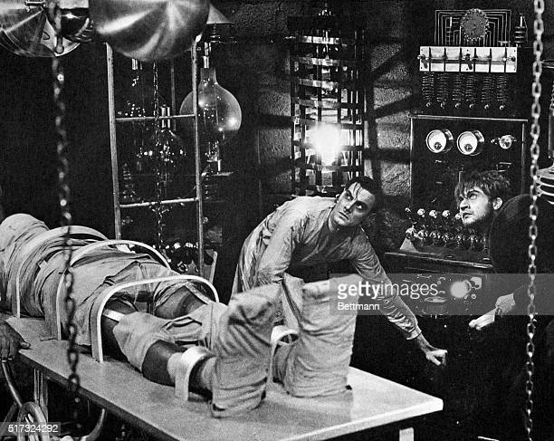 Colin Clive as Dr Frankenstein and Dwight Frye as his assistant Fritz prepare to bring their monster to life in a scene from the 1931 movie version...