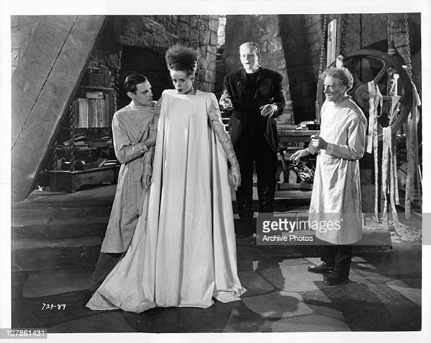 Colin Clive Boris Karloff Ernest Thesiger watch Elsa Lanchester walk in a scene from the film 'Bride Of Frankenstein' 1935