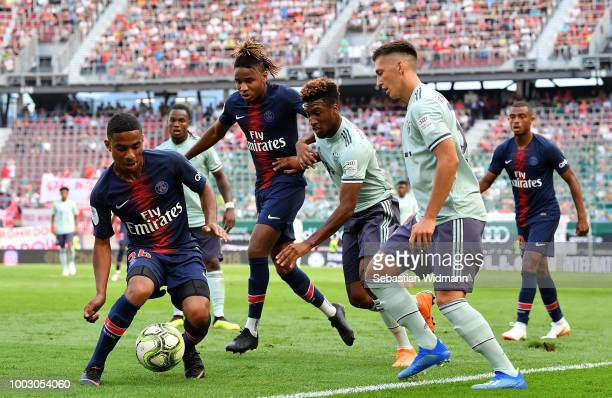 Colin Dagba of Paris SaintGerman looks to control the ball under pressure from Kingsley Coman and Jonathan Meier of Bayern Munich during the...