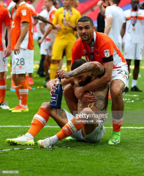 Colin Daniel of Blackpool helps up a worse for wear Kyle Vassell of Blackpool as they celebrate promotion after the Sky Bet League Two Playoff Final...