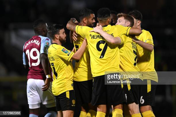 Colin Daniel of Burton Albion celebrates with teammates after scoring his team's first goal during the Carabao Cup Second Round match between Burton...